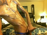 adrian cristiano gets oiled up for work webcam